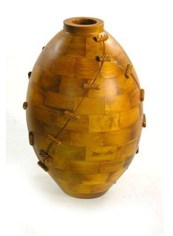 vaso-etnic-in-legno-panciuto-e-con-legacci-in-diverse-finiture.jpg